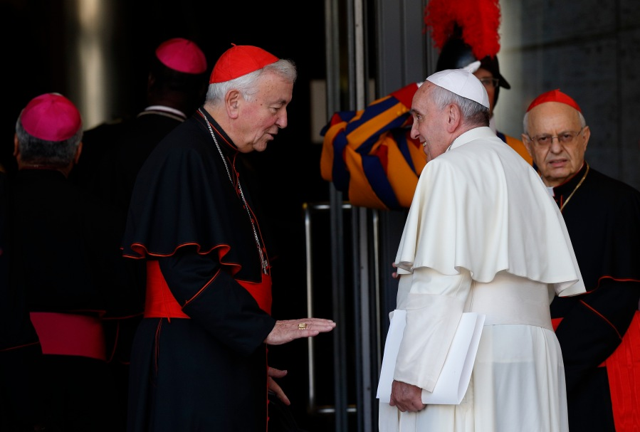 Cardinal Nichols talks with Pope Francis as they arrive for concluding session of extraordinary Synod of Bishops on the family